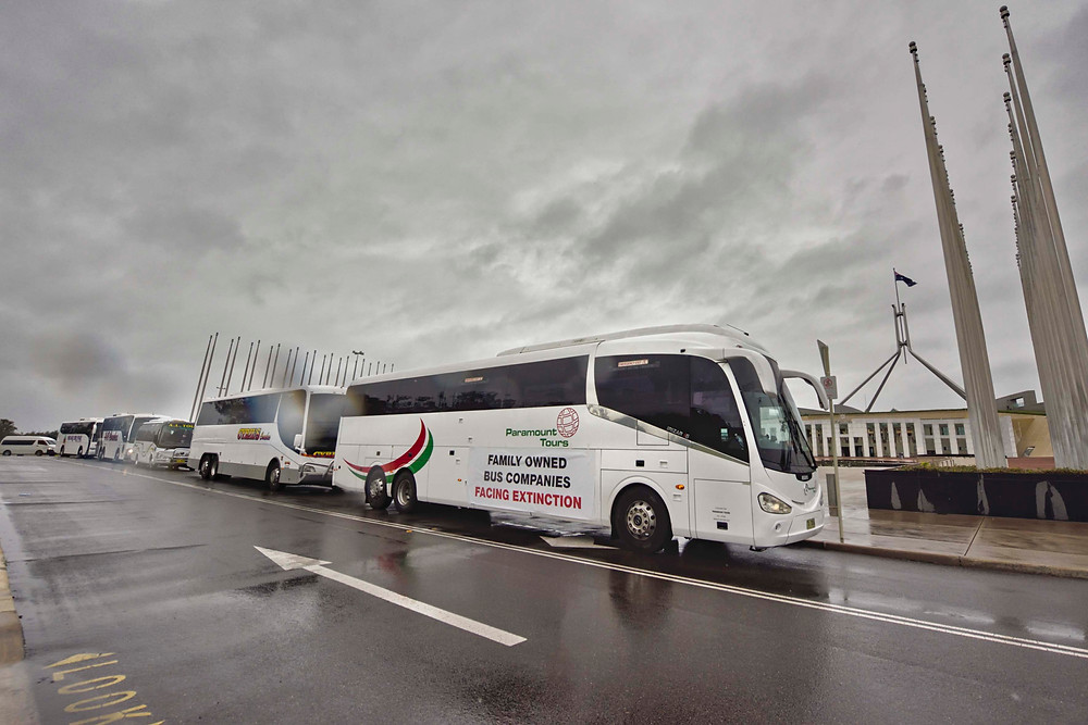 Family owned bus companies on the lawns of Parliament in Canberra.