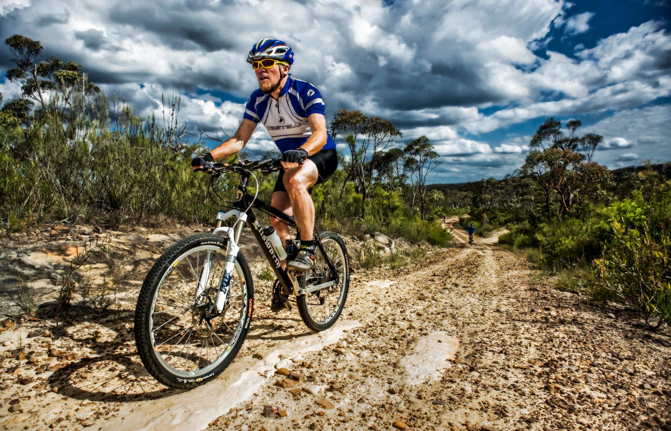 Mountain biking along the Oaks track between Glenbrook and Woodford