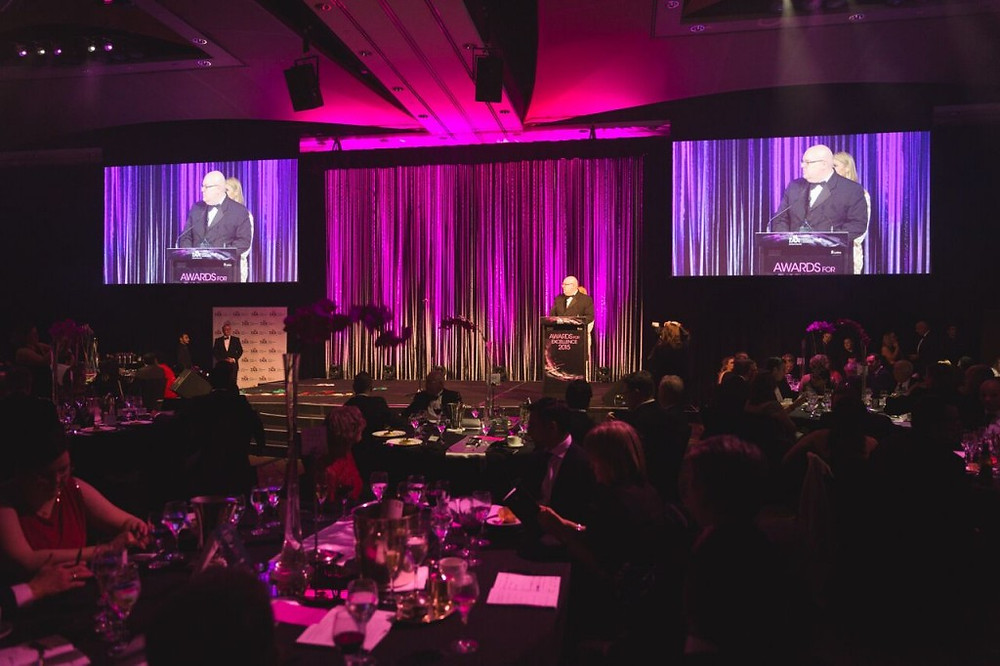 Escarpment Group revenue and yield manager Daryl Walker accepts another gong for the hotel business at the TAA awards