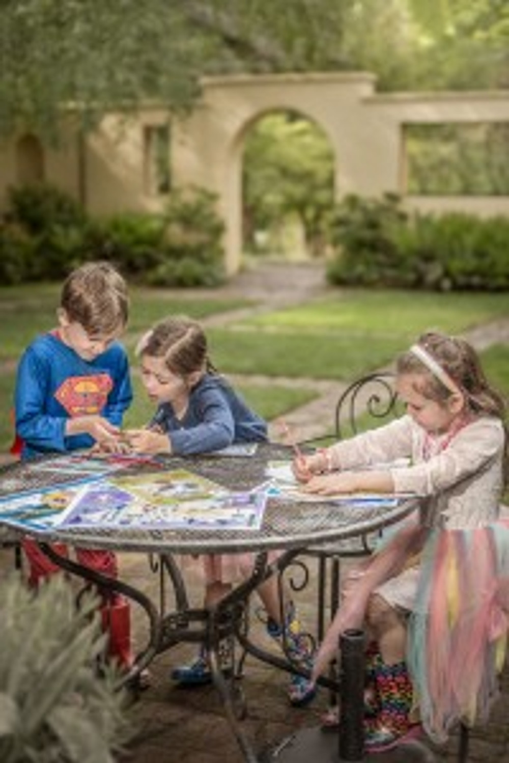 Henry Laurie, Georgia Anicic and Jessica Nutt enjoy doing some colouring in