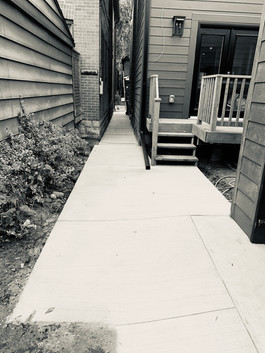 Ramp to garage and walkway.
