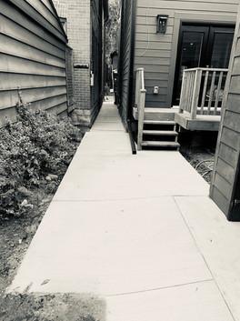 Ramp to garage and walkway.