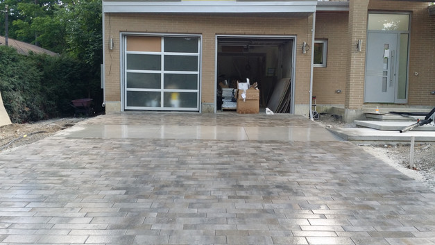 Concret with pavers.