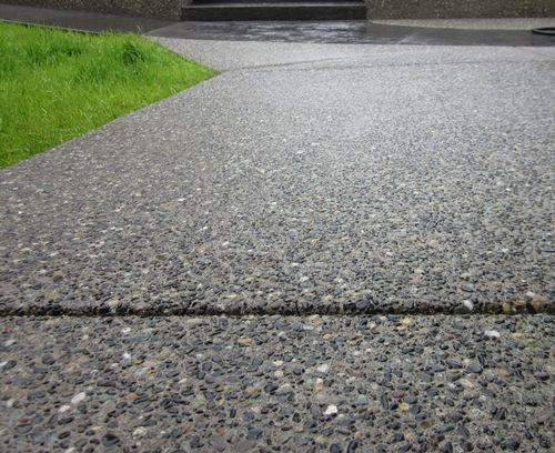 Exposed aggregate driveway close up.