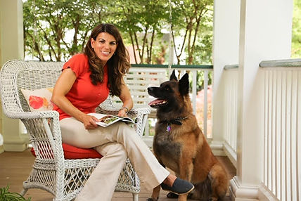 Dog Trainer Kristine with Dog sitting at attention