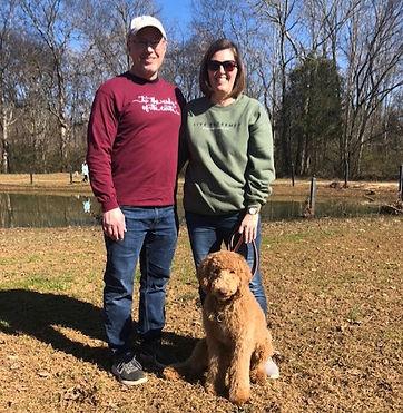 Dog training clients Scott an Karen with their dog Ellie