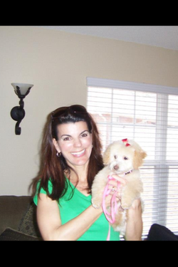 kristine-holding-training-client-dog