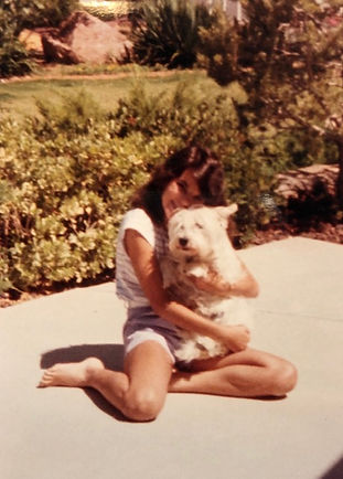 Kristine as a child holding her dog