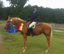 Myisha and Holly taking grand champion of Long Stirrup, 2nd in medal, and 2nd in eq challenge and 3r