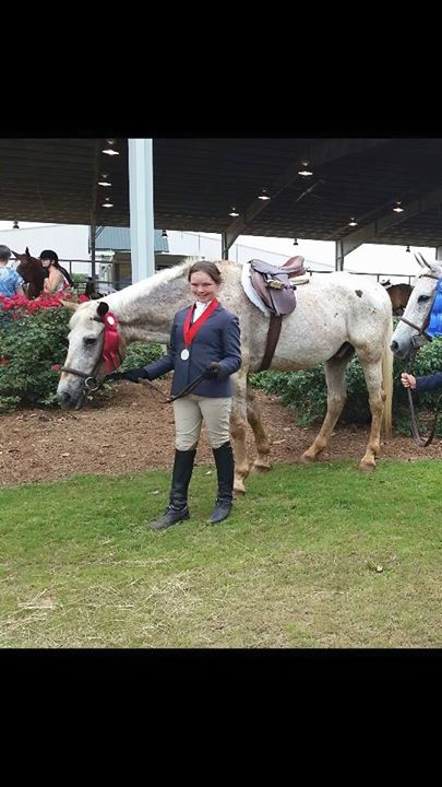 Tay enjoying her 4-H 2nd place for eq pattern 2015. It was her first year competing. Poncho looks as