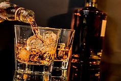 bigstock-Barman-Pouring-Whiskey-In-Fron-98511188.jpg
