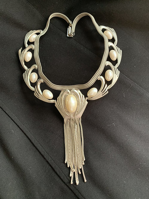 Beautiful silver tone pearl and tassel signature fashion necklace