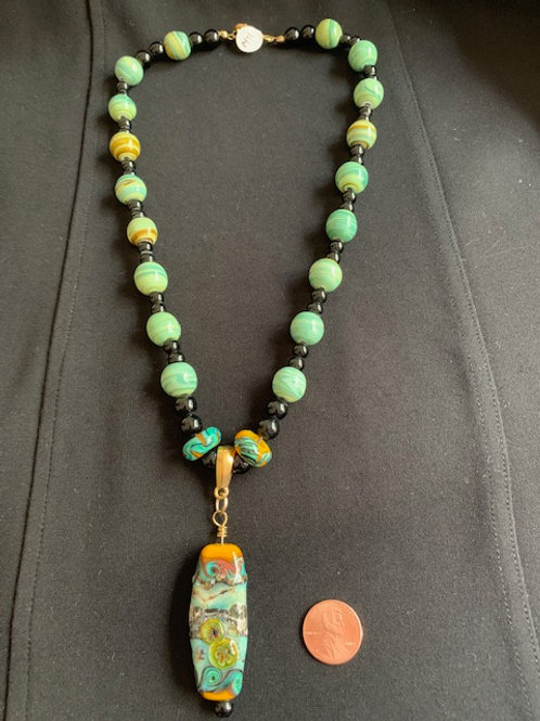 Green glass beaded necklace and pendant