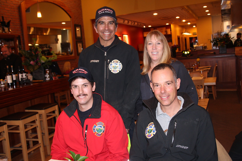 Engineer Mike Aronson (top left), Firefighter Jarod Miller (bottom left) and Captain Lou Vito (bottom right) join Seasons owner Karen Barger (top right).