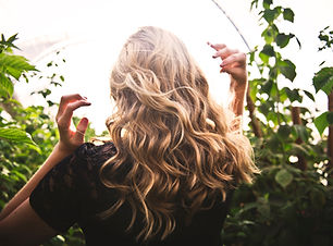 Woman with curled and styled hair.