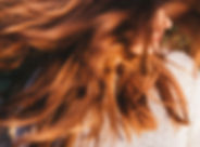Woman with red hair color.