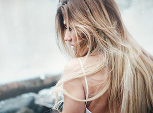Blonde woman with a partial highlight haircolor.