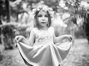 Flower girl hairstyle with flower crown.