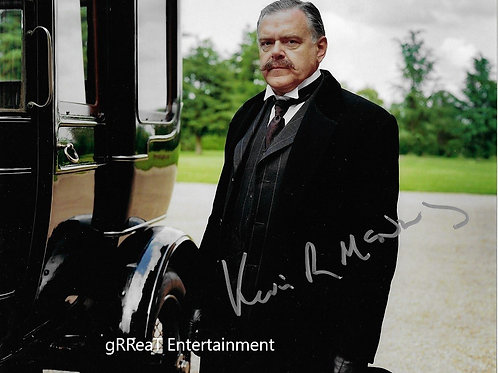 Kevin McNally autographed 10 in x 8 in. Photo