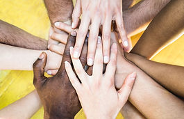 Top view of multiracial stacking hands -