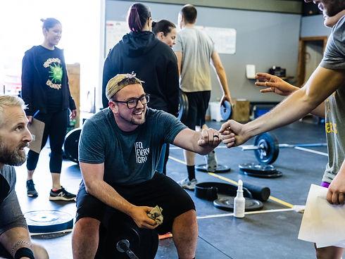 man-giving-fist-bump-after-workout.jpg