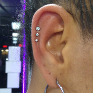 Three outer helix piercings