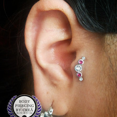 Tragus Piercing with gem cluster