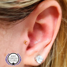 Tragus Piercing w/ Yellow Gold Moon