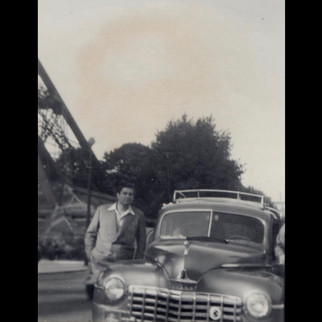 1950s Road Trip to Europe : Aleko in front of Eiffel