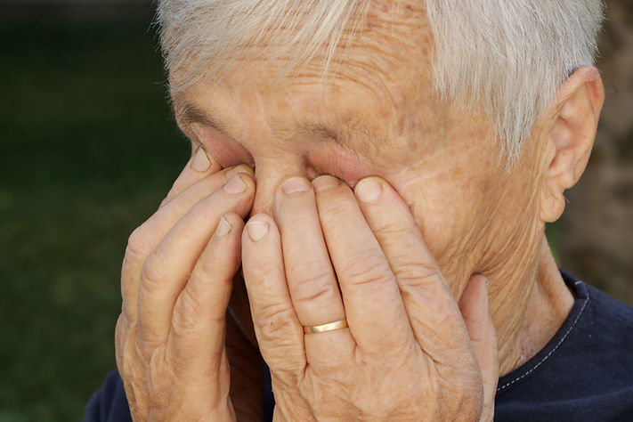 Senior caucasian woman rubbing her eyes.jpg