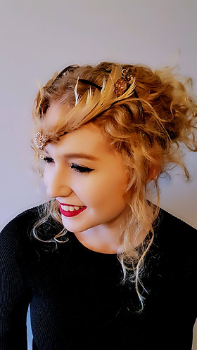 Spring racing  feathered crown  fascinator   millinery.