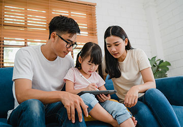 Parents teaching daughter