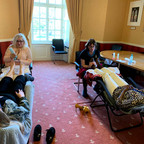 Attendees experiencing a Reflexology Treatment