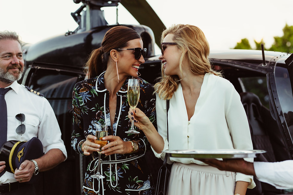 Cheerful female friends having wine outs