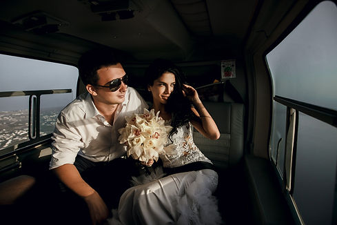 Happy beautiful newlyweds in the helicopter.jpg