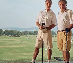 senior friends playing golf