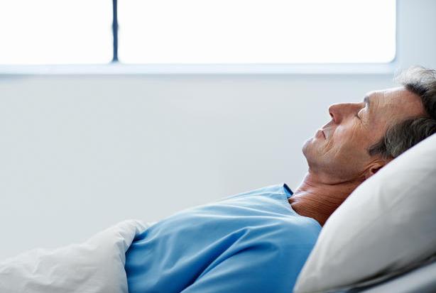 An elderly man sleeping comfortable