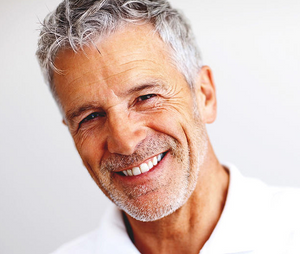 An elderly man smiling