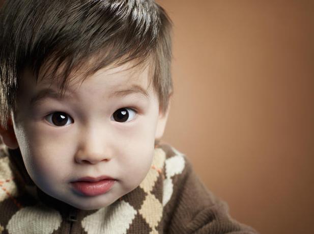 little boy looking surprised