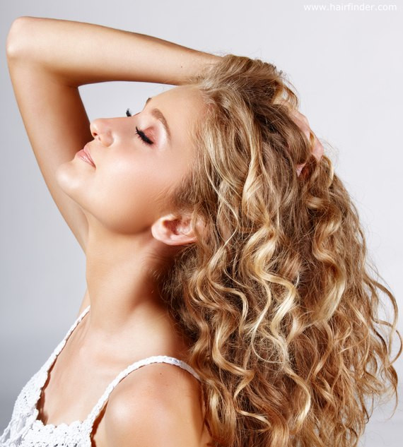 "Permanent Waves (""Perms"") and Body Waves  Price Range: $150 - $250 (Price is dependent upon hair length)  Perms are an ideal solution for adding body to fine, limp hair. It can provide loose, sexy waves or tight, corkscrew curls. It also has the ability to be applied to curly or wavy hair for straightening, especially if you're not seeking the higher degree of straightening from keratin smoothing treatments.  The key difference between a perm and a body wave is the size of the tools used in wrapping the hair. I use different strengths of formulas and different rod sizes to achieve the desired effect. The key advantage of a body wave (especially in long hair) isn't so much to get curls but to improve the ""body"" of the hair, allowing it to better hold various styles.  These services generally take 1-2 hours, depending upon the length of your hair. I apply a single chemical solution to break the structural bonds in your hair and then apply a neutralizer. It's also important to keep in mind that a perm takes a day to relax and that the thicker your hair, the better the perm will take.  Most perms generally last about 4-6 months – it doesn't wash out, but rather grows out over time. My preferred product is Goldwell, a leader in the industry for over 50 years. Goldwell products are enriched with Alpha Hydroxy Acids (AHA) which are derived from fruits, help seal in moisture, and smooth the hair cuticle, leaving the hair better able to reflect light and allow increased shine.  Goldwell's FortiCurl Complex also forms a protective layer on the hair, reinforcing areas that are fragile. The hair structure is smoother, resulting in defined curls with a minimum of color loss on color treated hair."
