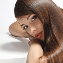 Keratin Smoothing Treatment  Price Range: $250 - $400 (Price is dependent upon hair volume and length)  Keratin Smoothing Treatments are ideal for straightening hair without damaging your hair follicles and concentrate on removing frizz, repairing damage, and improving the overall appearance of your hair.  Keratin is a protein that naturally exists in your hair. The product is applied using the heat of a flat iron tool to seal it in, a process that takes about 90 minutes or longer (depending upon your hair length).  For individuals who usually style their hair straight, these treatments shorten blow-drying time by 40-60% and results last for 2-3 months.