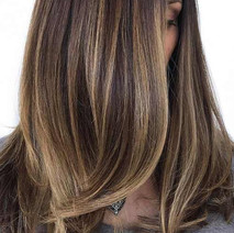 """Highlights are great for mimicking the beautiful light strands that are associated with """"sun kissed"""" hair. When applied to dirty blonde or mousy brown hair, highlights transform these colors into shades that are rich, beautiful and alluring.  Partial Highlights       Price: from $80  I use partial highlights to draw attention to certain features, accentuate a style, or create a new look for a simple cut.    Full Highlights      Price: from $150  With full highlights, I evenly highlight your entire head to break up color that may be too flat or one-dimensional. I often apply highlights in two or more different shades – either with shades lighter than the base color (and one shade lighter than the other) or with one shade being lighter and one darker than the base color. The latter style of highlighting is called """"dimensional coloring"""" and is used to produce a more natural and pleasing look.  Lowlights are similar to highlights. Instead of removing color to create lighter strands that highlight the hair, I use color to create darker strands that add warmth to the hair. Lowlights are a great option for many with salt and pepper gray hair and want to put a bit more """"pepper"""" back into the hair.  To maintain a full head of highlights or lowlights, crown re-growth should be re-touched in one or two 4-6 week interval visits, with a return for a full head. Another option is to have the full head followed by a half-head about 3 months later and then a full head 3 months after that."""
