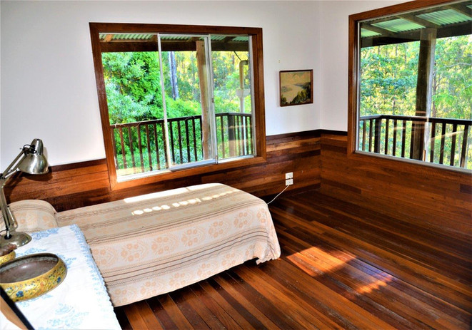 bedroom forest view and private balcony