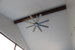 Gym fan and stained beam