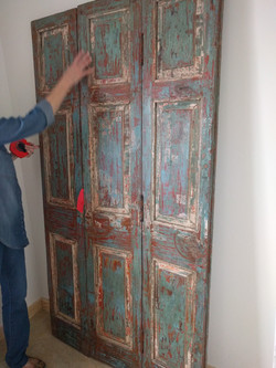 Found shutters used as wall paneling