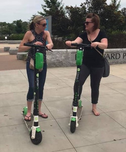 Tori and Cara on scooters