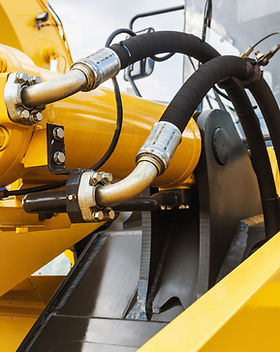 hydraulics tractor yellow. focus on the