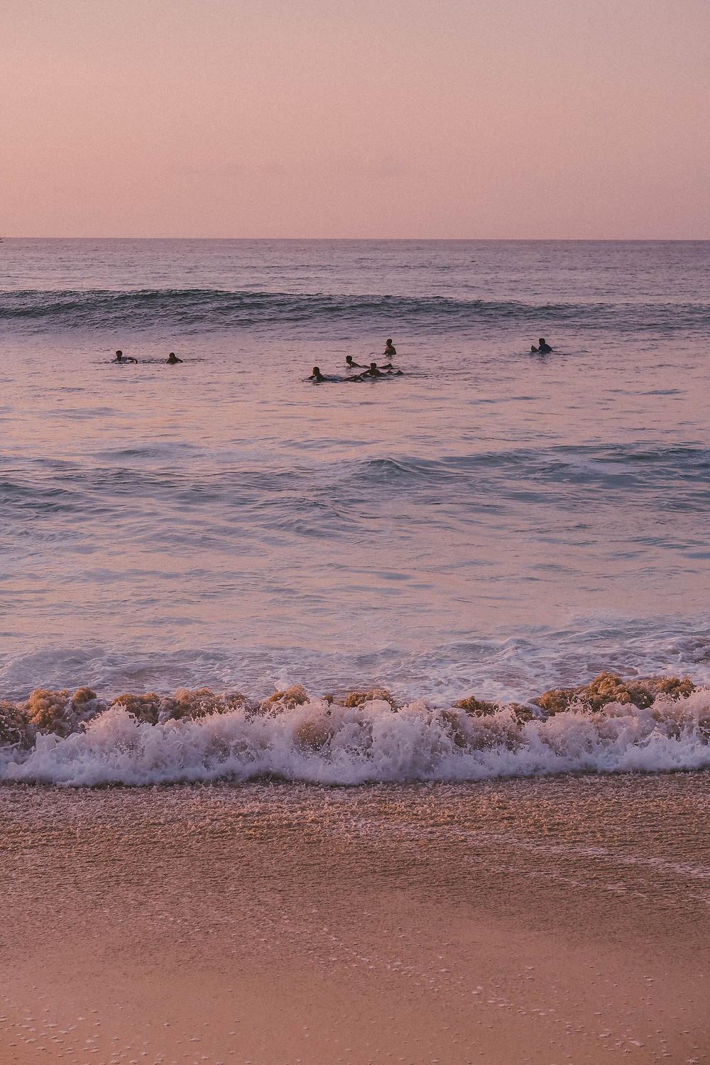 Surfers at Dreamland Beach