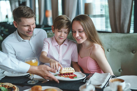 young-family-in-a-restaurant-PKHZ8DN.jpg