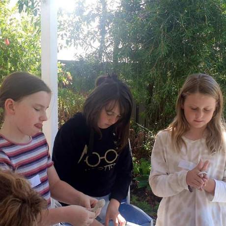 Sculpting clay goddesses